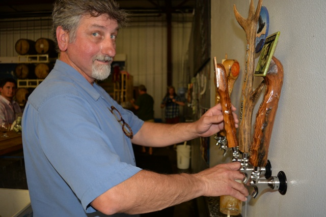 (Keno helps out behind the bar at Parkway Brewing)