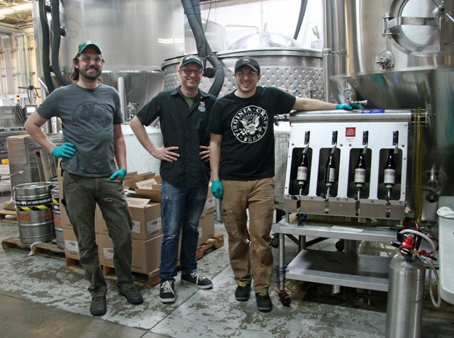 (L-R) Nick Anderson, Jasper Akerboom and Nassim Sultan bottle the Stublendious sour. The bottles are capped, labeled, and wax dipped by hand.