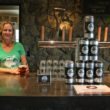 (Janell Zurschmeide behind the bar in the Dirt Farm tasting room)